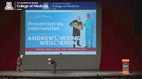 After introducing Dr. Andrew Weil, Dr. Robbins bows to him