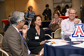 Drs. Sai Parthasarathy and Indu Partha, his wife, chat with Dr. Conrad Clemens