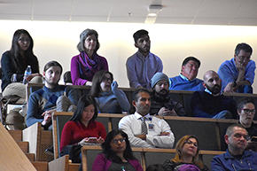 UA Sarver Heart Center's Katie Maass (back row, 2nd from left) watches Shark Tank contest for COM-T Research Day 2019