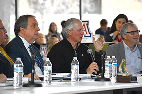 UA President Dr. Robert Robbins asks question at Shark Tank contest for COM-T Research Day 2019
