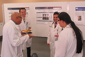 UA physicians discuss research posters at GME Scholarly Day South Campus