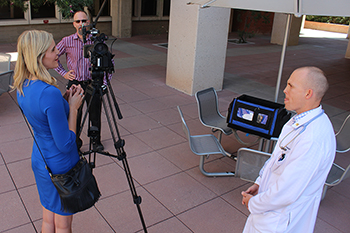KVOA's Kendra Hall asks a question of Dr. Norm Beatty