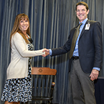 Deputy Dean for Education Kevin Moynahan, MD, presents Amy Sussman, MD, with her honorary chair as 2018 winner of the Basic Science Educator of the Year – Lifetime Award