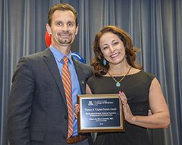 Dr. Erika Bracamonte (right) with presenter Dr. Todd Vanderah