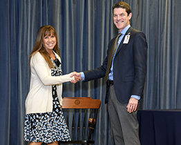 Dr. Amy Sussman receives chair for Basic Science Educator of the Year Lifetime Award from Dr. Kevin Moynahan