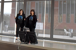 Drs. Monica Kraft and Julie Ledford show off lung T-shirts at Shark Tank contest on COM-T Research Day 2019