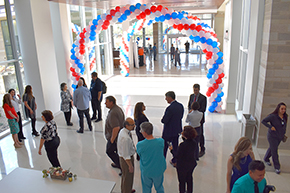 Executives greet attendees beneath balloons at new Banner – UMC Tucson hospital tower morning open house