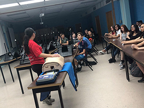 Health education assistant Erika Yee instructs high school students on the benefits of chest-compression-only CPR