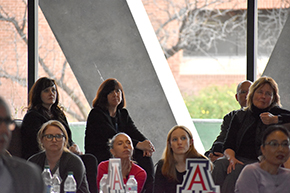 Back row, from left, Drs. Julie Ledford, Monica Kraft and Anne Cress with Todd Boltz (behind Dr. Cress) watch Shark Tank contest on COM-T Research Day 2019