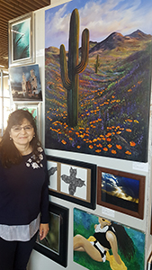 Carolyn Bothwell, Division of Infectious Diseases, with her painting of saguaro and Mexican poppies (courtesy of Karena Nespoli)