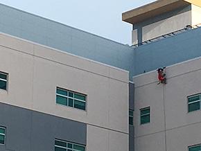 Wilbur rappells down side of hospital