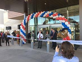 Tucson Mayor Jonathan Rothschild steps up to the ribbon
