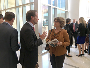 UA Senior Vice President and Chief Marketing and Communications Officer Steve Moore chats with Dr. Esther Sternberg