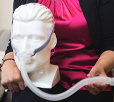 CPAP (continuous positive airway pressure) breather on a dummy head