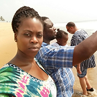 "Dr. Bailey's wife, Eva, him and daughter on Ouidah Beach. ""We bring people to that same site every year. It's like a pilgrimage. A monument there is called the Door of No Return. My father-in-law has built on that same site the first door of return for those coming back from the diaspora."""