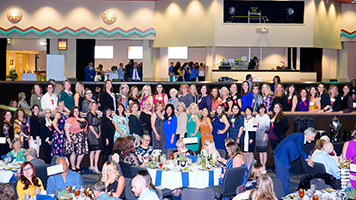 Dr. Monica Kraft (bottom row, 2nd from right) among winners and finalists at 2019 Women of Influence Awards ceremony, Sahuarita, March 6, 2019