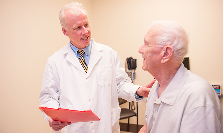 Dr. Craig Stump sees a patient at the Diabetes Clinic in the Abrams Public Health Center adjacent to Banner – University Medical Center South Campus [Courtesy: Ziemba Photographic Arts]