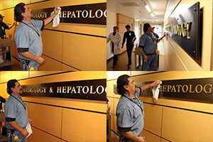 UA Facilities' Danny Rodriguez (blue shirt) and Adam Jacobs put finishing touches on new Division of Gastroenterology signage