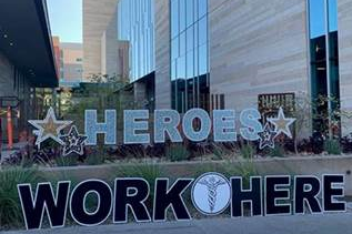 Heroes Work Here sign in front of hospital