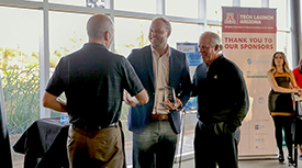 Doug Hockstad, Adam Small of Urbix Resources, and UA President Robert C. Robbins. (Photo credit: Tech Launch Arizona)