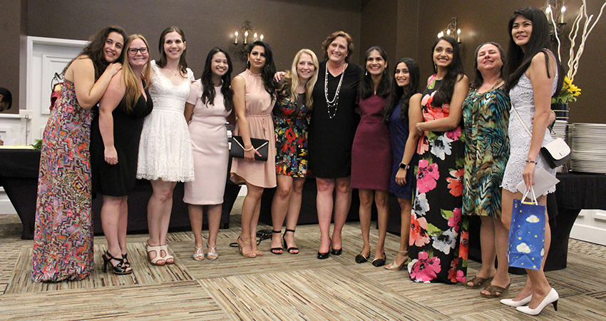 Several ladies among graduating residents gather for group shot with program coordinators Mary Gosciminski and Laynie Drenske