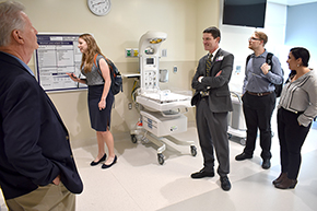 Dr. Kevin Moynahan leads a tour of patient rooms