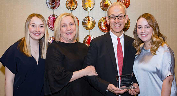 Dr. Marvin J. Slepian, second from right, celebrates his 2019 UA Engineering da Vinci Fellowship with his wife, Donna, second from left, and his daughters, Becca and Sara. (Courtesy of the UA College of Engineering)