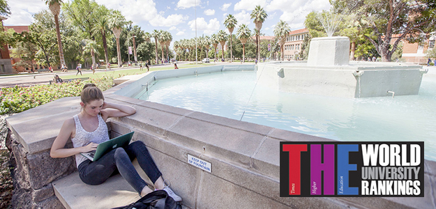 Girl by Old Main fountain with World University Rankings logo