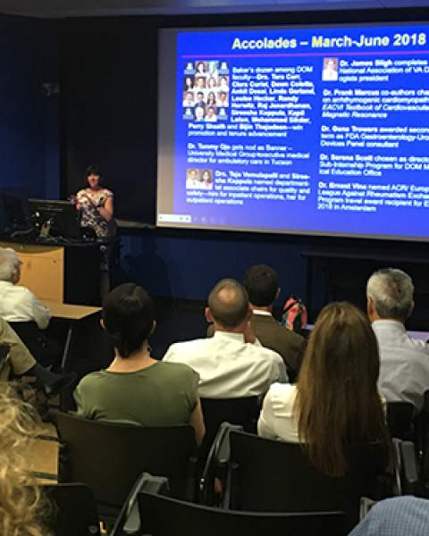 DOM Chair Dr. Monica Kraft addresses faculty at June 2018 general faculty meeting