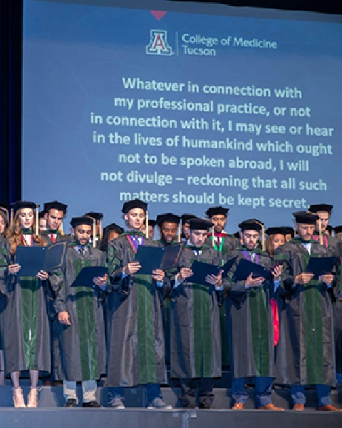 Teaser image of new physicians taking Hippocratic oath for this story.