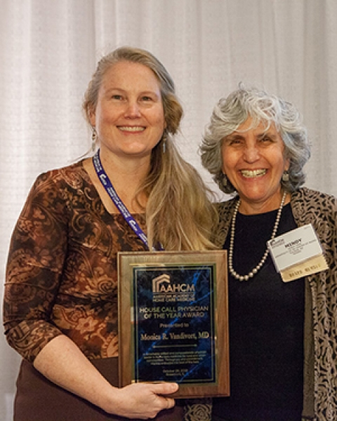 Drs. Monica Vandivort and Mindy Fain with Dr. Vandivort's AAHCM award