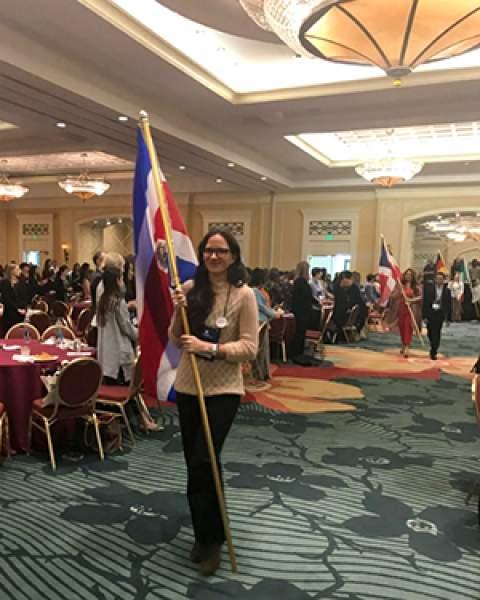 Rosanna Mauro carries Costa Rican flag at IAEDP Symposium