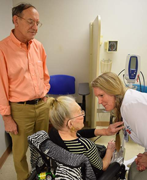 Dr. Monica Vandivort seeing a patient and her son in clinic at Banner - UMC Tucson