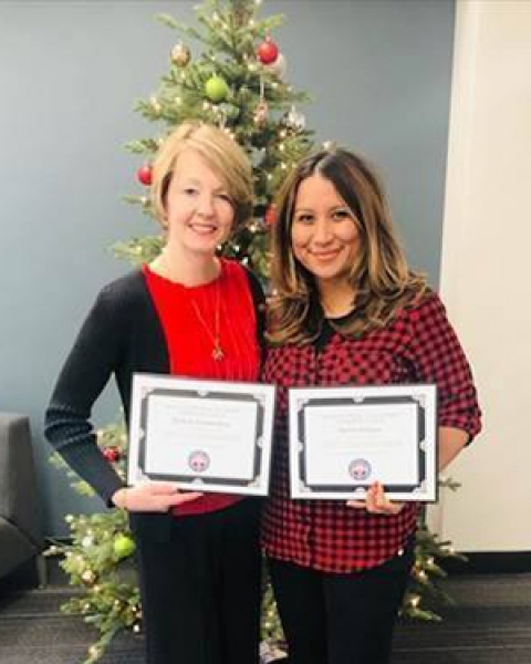 Michele Dalmendray and Barbra Solares with certificates of recognition as GME Administrators Liaison appointees