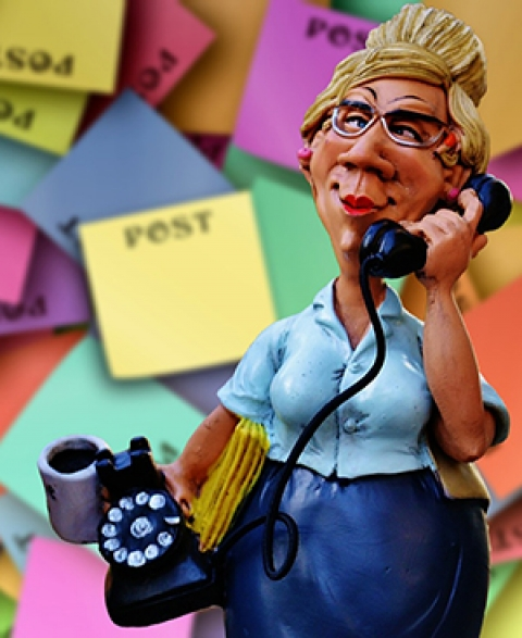 secretary on phone with post-its