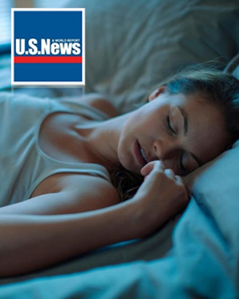 U.S. News logo with sleeping woman